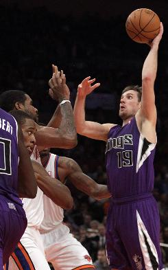 Sacramento's Beno Udrih shoots over New York's Shawne Williams, left, and Toney Douglas during the second half on Friday. Udrih scored 29 points in the Kings' 93-83 win over the Knicks.