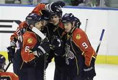 The Panthers' David Booth, second from left, is congratulated by Dennis Wideman (6) and other teammates after scoring a second-period goal. Wideman recorded the game-winner in overtime.