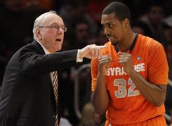 Syracuse coach Jim Boeheim, left, talks with Kris Joseph during the first half of their 76-59 win over St. John's on Wednesday.