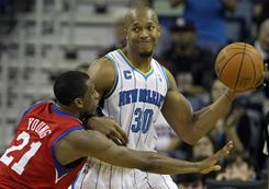"Forward David West, right, has been a steady contributor with the Hornets for six seasons, making the All-Star team on two occasions. West however is not one to seek out the spotlight. ""David is a different type of dude,"" teammate Emeka Okafor says. ""He's very basketball savvy, but he has other interests outside it."""
