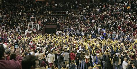 Florida State fans rush the floor after the unranked Seminoles upset Duke's top-ranked Blue Devils 66-61 Wednesday night.