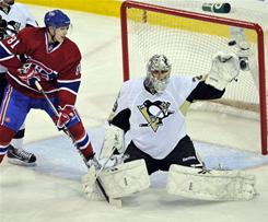 Penguins goalie Marc-Andre Fleury, snaring the puck in his glove during the second period as Canadiens center Lars Eller (81) looks on, recorded 20 saves in Pittsburgh's 5-2 win.