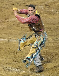 Bull rider Ben Jones does a dance in the arena after scoring an 85.75 on Blingin' Saturday night in Nampa, Idaho in the Professional Bull Rider's Nampa Invitational.