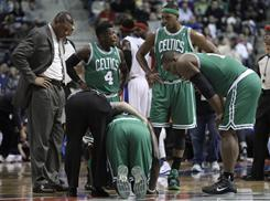 The Celtics, anchored by mid-30ish stars, have won despite injuries. Kevin Garnett, surrounded by teammates and coach Doc Rivers, left, went down Dec. 29 vs. the Pistons but could be back Monday.