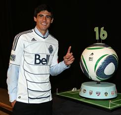 Omar Salgado, chosen No. 1 overall by the Vancouver Whitecaps, poses during the 2011 MLS SuperDraft.