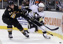 The Bruins' Adam McQuaid, left, battles for the puck with the Penguins' Chris Conner during the first period of their game Saturday in Boston. Pittsburgh won 3-2.