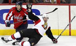 Brooks Laich, pulling down  Senators captain Daniel Alfredsson, started the  Capitals' rally with a third-period goal.