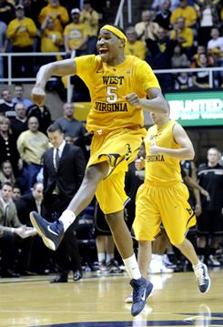 West Virginia's Kevin Jones celebrates in the final seconds of an upset victory over Purdue in Morgantown, W.Va. Jones scored 17 points in the West Virginia win.
