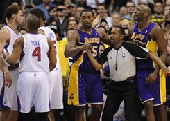 Referee James Capers holds back Los Angeles Lakers' Ron Artest, center, and Lamar Odom, right, as Los Angeles Clippers' Randy Foye (4) and Ryan Gomes hold back teammate Blake Griffin, left, after a scuffle in the second half of their game at the Staples Center in Los Angeles. The Clippers won 99-92. Odom, Griffin, Artest and Baron Davis all were ejected.
