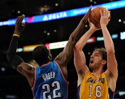 Despite having his shot blocked by the Thunder's Jeff Green (22), Pau Gasol (16) finished with 21 points and the Lakers beat the Thunder 101-94.