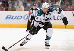 Patrick Marleau (12) of the San Jose Sharks skates up ice during Monday's game with the Phoenix Coyotes at Jobing.com Arena in Glendale, Arizona on Monday. Marleau played in his 1,000th career game and scored a goal in the Sharks' 4-2 win over the Coyotes.