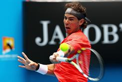 Rafael Nadal of Spain rips a forehand in his first-round victory against Marcos Daniel of Brazil on Tuesday (Monday night ET) on Day 2 of the Australian Open in Melbourne. Nadal was leading 6-0. 5-0 when Daniel retired with an injury.