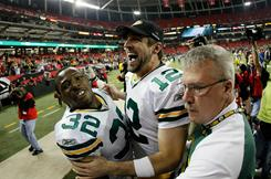 Packers quarterback Aaron Rodgers (12) and Brandon Jackson celebrate as they walk off the field after the Packers won 48-21 against the Falcons during the NFC divisional playoff game at the Georgia Dome.