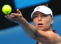 Vera Zvonareva of Russia winds up to serve during her first-round victory 6-2, 6-1 against Sybille Bammer of Austria on Day 2 of the Australian Open