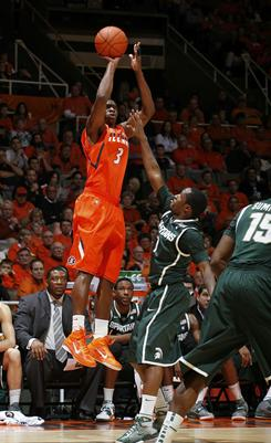 Illinois' Brandon Paul (3),   taking a three-point shot against Michigan State during their game  Tuesday, scored 20 points in the Fighting Illini's 71-62 win over the Spartans.