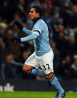 Argentine striker Carlos Tevez celebrates his goal that helped Manchester City down Leicester 4-2 in the FA Cup.