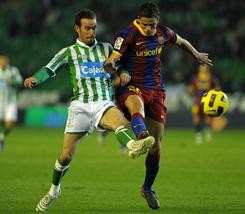 Fernando Vega, left, and Real Betis handed Ibrahim Afellay and Barcelona their first loss in 28 games.