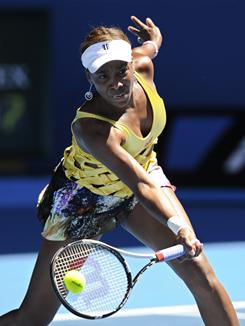 Venus Williams drops her racquet to pick up a low forehand during her second-round match against Sandra Zahlavova of the Czech Republic. Williams overcame an injury to gut out a 6-7 (6-8), 6-0, 6-4 win.