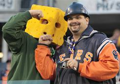 Packers and Bears fans will be at odds Sunday when their teams face off in the NFC Championship Game.