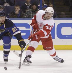 Darren Helm, right, scored the game-winner in overtime to help the Red Wings rally for a win after blowing a three-goal lead.