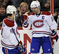 Brian Gionta, right, and Max Pacioretty each scored to help the Canadiens rout the Senators 7-1 and improve to 7-1-2 in their last 10 games.