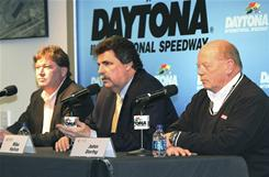 NASCAR executives Robin Pemberton, left, President Mike Helton, center, and John Darby address the media Friday at Daytona International Speedway.