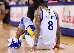 Golden State Warriors shooting guard Monta Ellis reacts after injuring himself during overtime against the Sacramento Kings on Friday. The Warriors say the ankle won't need X-rays, and Ellis says it's just a little sore. The Warriors defeated the Kings 119-112.