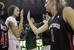 Baylor's Brittney Griner, left, and Texas Tech's Jordan Barncastle greet each other after their game in Waco, Texas. Baylor won 64-51. Griner punched Barncastle in the face during their previous meeting last season.