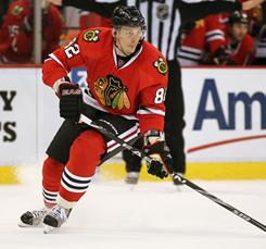 Tomas Kopecky scored twice to help the Blackhawks beat the Red Wings and run their unbeten streak to six games.