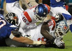 East defensive tackle Marvin Austin, right, of North Carolina, recovers a fumble in the endzone for a touchdown during the second half of the East-West Shrine Game in Orlando.