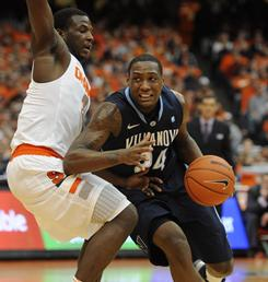 Villanova guard Corey Stokes drives against Syracuse's Dion Waiters in the first half of their matchup at the Carrier Dome. The No. 7 Wildcats beat the third-ranked Orange 83-72.