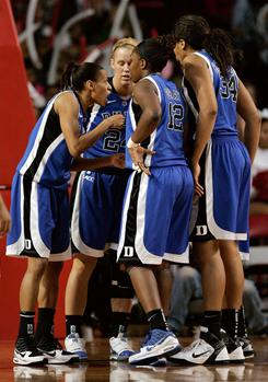 Duke Blue Devils guard Jasmine Thomas, left, addresses her team during the first half of their game against the North Carolina State Wolfpack. Duke rallied from down 20 to win 65-64.