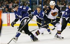Tampa Bay Lightning center Steven Stamkos (91) trips up Atlanta Thrashers right wing Anthony Stewart (22) during the third period of Sunday's game the St. Pete Times Forum. Stamkos scored his league-leading 38th goal in Tampa Bay's 7-1 rout of Atlanta.