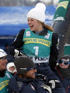 Aerials skier Ashley Caldwell is carried to a medals ceremony by teammates after winning her first World Cup event at the Nature Valley Freestyle Cup in Lake Placid, N.Y.