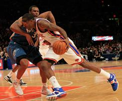 Forward Amar'e Stoudemire had 30 points to help the Knicks snap a six-game skid. New York defeated the Washington Wizards 115-106 on Monday night.