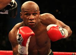 Floyd Mayweather Jr., above against Shane Mosley during their May 2010 fight, is accused of hitting and threatening his ex-girlfriend.