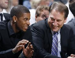 Michigan State coach Tom Izzo, right, talks with Korie Lucious on the bench during a game against Eastern Michigan on Nov. 12. Izzo suspended Lucious for that game after pleading guilty in September to misdemeanor reckless driving and suspended him for the rest of the season on Tuesday.