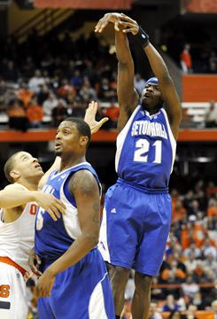 Seton Hall's Jeremy Hazell (21) hits a three-point shot during the first half of a road game against Syracyse on Tuesday night. Hazell finished with 28 points, including five three-pointers, in the Pirates' surprising 90-68 win over the Orange.
