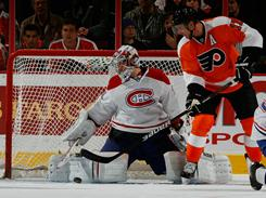 Canadiens goaltender Carey Price (31) looks over his shoulder as the Flyers' Jeff Carter (17) scores a goal past him in the first period of their game at the Wells Fargo Center in Philadelphia on Tuesday night. The Flyers will go into the All Star Break with an NHL-best 33 wins.