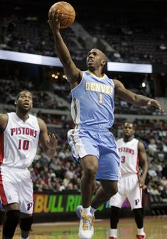 Chauncey Billups had 26 points to help the Nuggets win at Detroit for the first time since March 1995.
