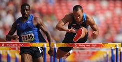 Bryan Clay of the USA leads Jangy Addy of Liberia on his way to winning a decathlon 110-meter hurdles heat at the Beijing Olympics in 2008.