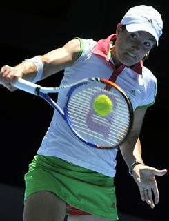 Justine Henin hits her trademark one-handed backhand during her third-round match against Svetlana Kuznetsova at the Australian Open on Jan. 21.