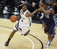 Providence's Marshon Brooks (2) drives to the basket against Villanova's James Bell (32) late in the second half of their Big East game in Providence on Wednesday night. Providence defeated Villanova 83-68 and Brooks led the Friars with 20 points.
