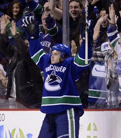 Vancouver's Lee Sweatt celebrates after scoring his first career goal in the NHL during the third period of their home game against Nashville on Wednesday night. Sweatt's goal proved to be the difference as the Canucks beat the Predators 2-1.
