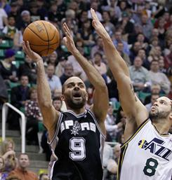 Tony Parker (9) had 23 points and six assists, and the Spurs held off Deron Williams (8) and the Jazz for the 10th win in 11 games.