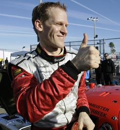 German driver Jorg Bergmeister gives a thumbs-up after winning the pole position during qualifying for the Grand Am Rolex 24 hour auto race at Daytona International Speedway.