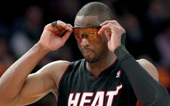 Dwyane Wade adjusts his tinted glasses in the first half of the Heat's game against the Knicks at Madison Square Garden in New York. Wade had to use lightly tinted goggles after the league rejected the first pair he had hoped to wear as being too dark. Wade had 34 points in the losing effort.