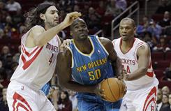 During the Hornets' 10-game winning streak, Emeka Okafor, center splitting the Rockets' Luis Scola and Chuck Hayes, has re-emerged, averaging 11.9 points, 11.9 rebounds and 1.7 blocks a game.