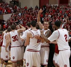 Indiana celebrates its upset of No. 21 Illinois, which snapped the Hoosiers' 19-game losing streak to ranked opponents.