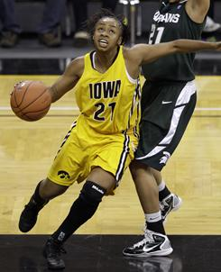 Kachine Alexander (21) had 23 points and 11 rebounds to help No. 21 Iowa hold off No. 11 Michigan State.